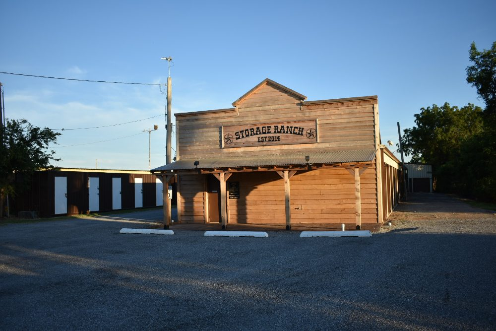 Image of the front of Storage Ranch's Duncan location. The building's architecture is classic western.