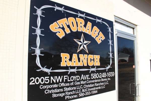Image of a Storage Ranch sign with logo and location address.