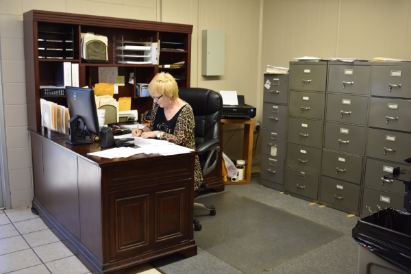 Image of a Storage Ranch employee, sitting at her desk.