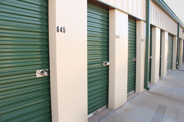 Image of the green, metallic doors on the smaller self storage units
