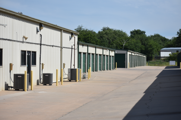 A row of storage units of various sizes.